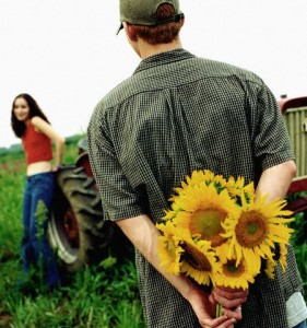 Man Holding Sunflower Bouquet